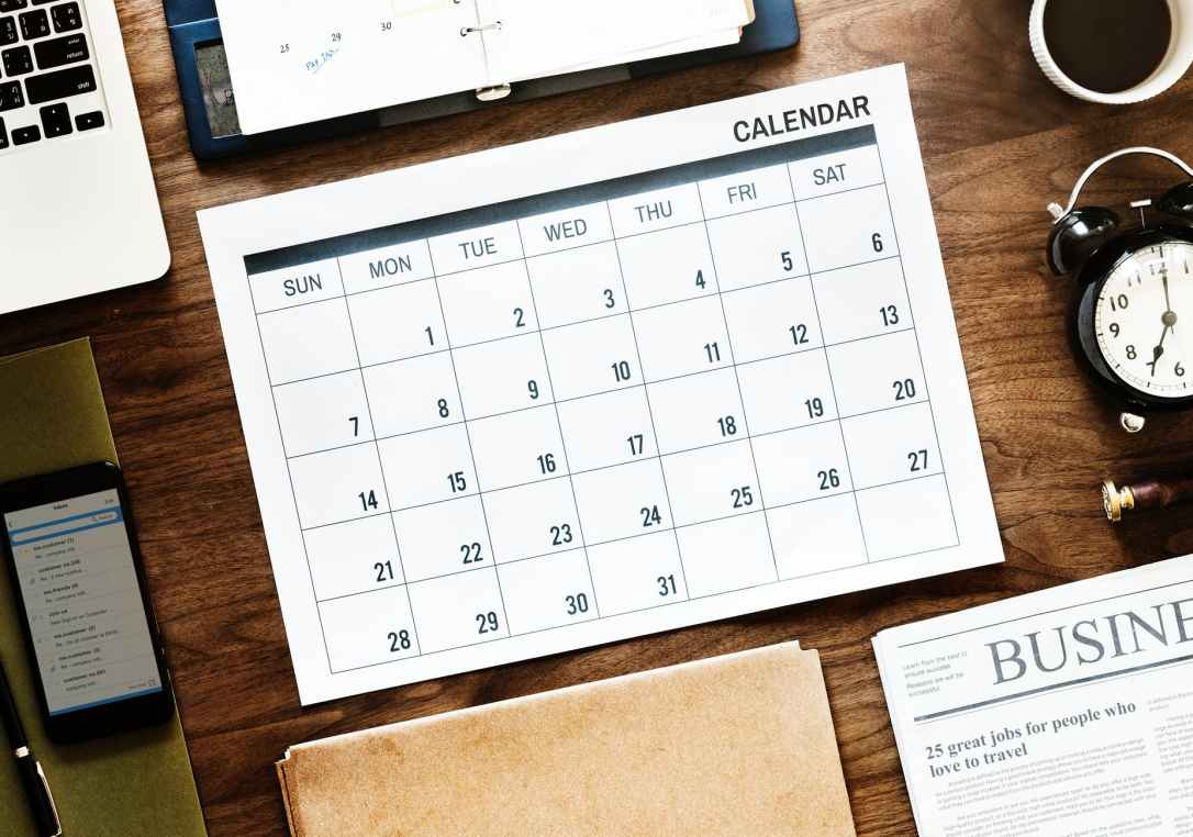 flat lay photography of calendar